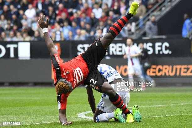 Lyon's French forward Maxwell Cornet vies with Rennes' French defender Joris Gnagnon during the French L1 football match between Rennes and Lyon on...