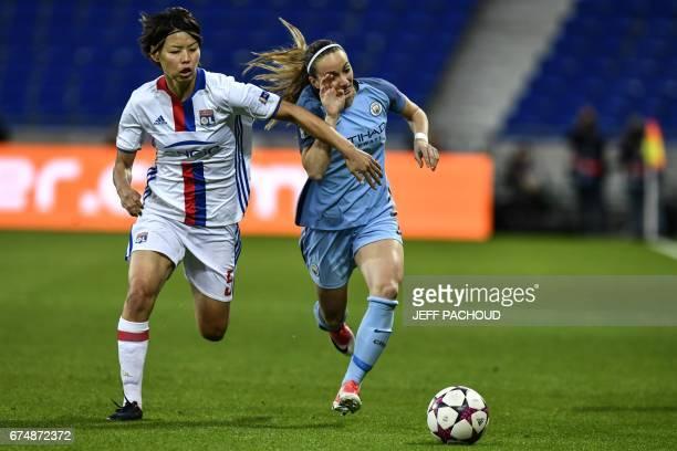 Lyon's Japanese defender Saki Kumagai outruns Manchester City's Swedish forward Kosovare Asllani during the UEFA Women's Champions League semifinal...