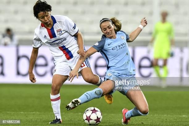Lyon's Japanese defender Saki Kumagai vies with Manchester City's Swedish forward Kosovare Asllani during the Women Champions League semifinal...