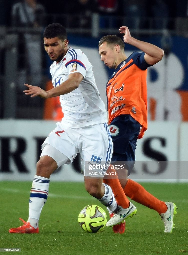 Lyon's Malian midfielder Sidy Kone (L) vies with Montpellier's French forward Kevin Berigaud (R) during the French L1 football match between Montpellier and Lyon on March 8, 2015 at the La Mosson Stadium in Montpellier, southern France. AFP PHOTO / PASCAL GUYOT