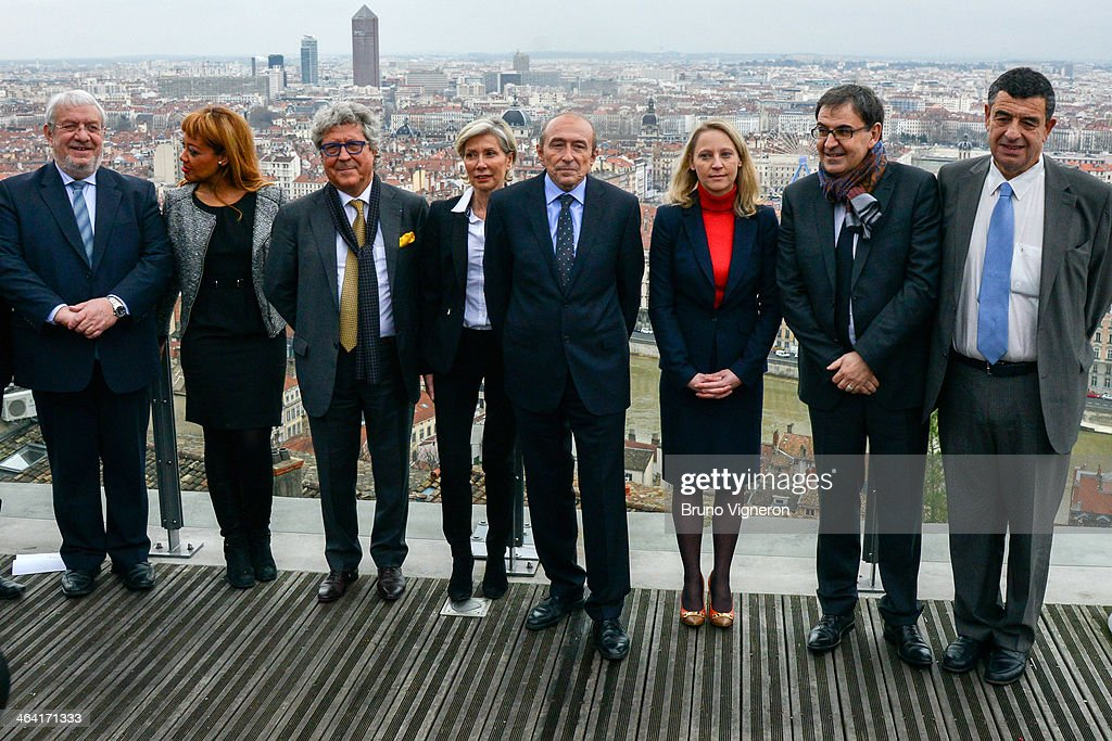Lyon's mayor and socialist party's candidate for the March 2014 mayoral elections in Lyon, <a gi-track='captionPersonalityLinkClicked' href=/galleries/search?phrase=Gerard+Collomb&family=editorial&specificpeople=672969 ng-click='$event.stopPropagation()'>Gerard Collomb</a> (C) poses with his candidates during a mayoral elections press conference on January 21, 2014 in Lyon, France.