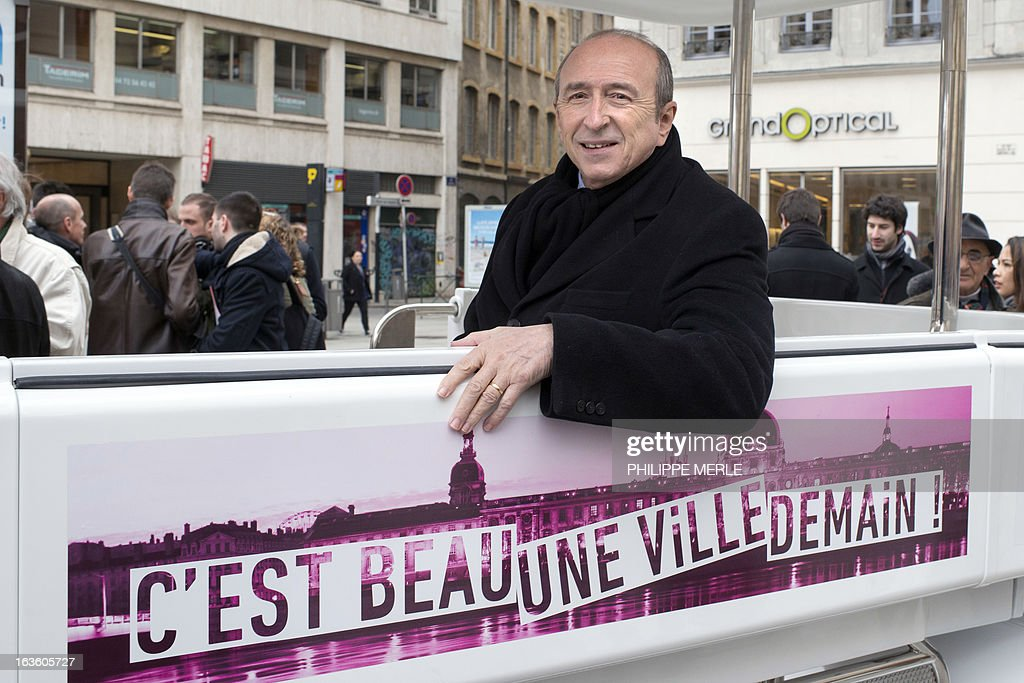 Lyon's mayor Gerard Collomb poses as he is seated in the urban driverless shuttle 'NAVIA' during its launch on march 13, 2013 in the east-central French city of Lyon. NAVIA is a driverless 8 passenger robotized shuttle, design for transportation in city centers. This shuttle is equipped with laser range finders, cameras and a software package that allows it to move autonomously and safely in any environment.