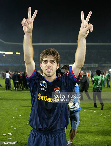 Lyon's midfielder Brazilian Juninho jubilates at the end of his French soccer L1 match against Montpellier 20 May 2003 at the La Mosson stadium in...