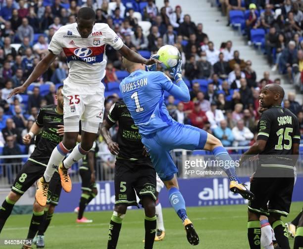 Lyon's midfielder Christopher Martins Pereira vies with Guingamp's Danish goalkeeper KarlJohan Johnsson during the French L1 football match Lyon vs...