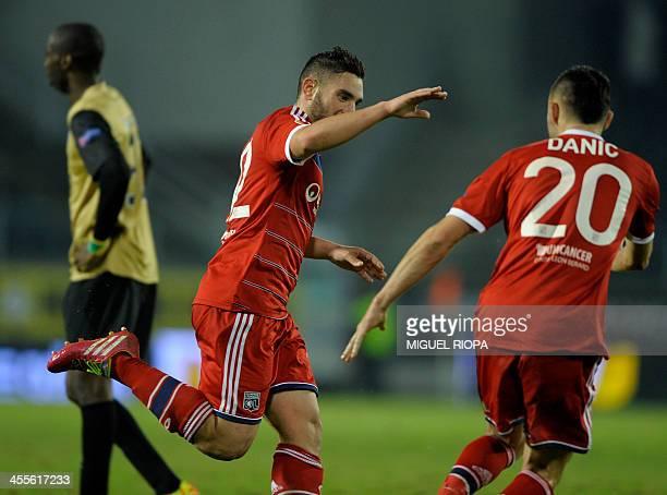 Lyon's midfielder Jordan Ferri celebrates with teammate Lyon's midfielder Gael Danic after scoring a goal during the UEFA Europa League Group I...