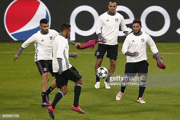 Lyon's midfielder Jordan Ferri of France Lyon's midfielder Corentin Tolisso of France Lyon's defender Jeremy Morel from France take part in a...