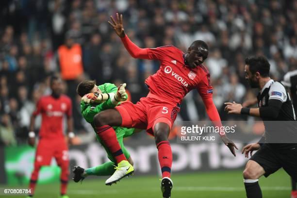 Lyon's Mounter Diakhaby vies with Besiktas' goalkeeper Fabri during the UEFA Europa League second leg quarter final football match between Besiktas...