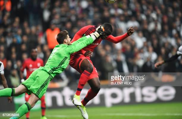 TOPSHOT Lyon's Mounter Diakhaby vies with Besiktas 's goal keeper Fabri during the UEFA Europa League second leg quarter final football match between...