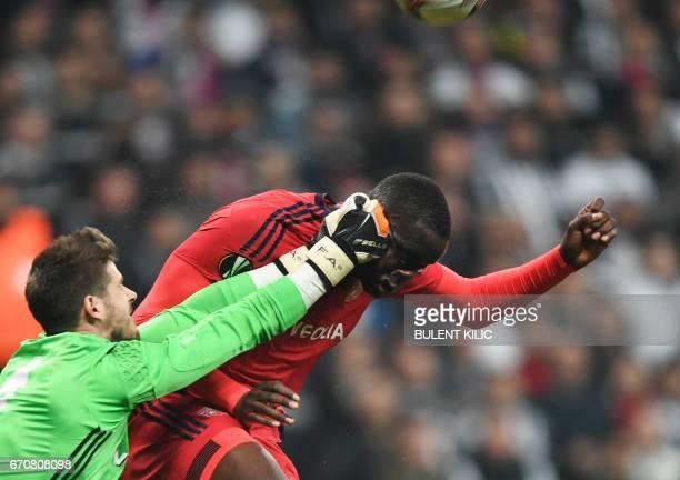 Lyon's Mounter Diakhaby vies with Besiktas 's goal keeper Fabri during the UEFA Europa League second leg quarter final football match between...