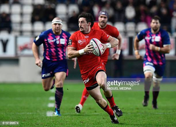 Lyon's New Zealander winger Henry CluniesRoss runs with the ball during the French Top 14 Rugby Union match Stade Français vs Lyon Lou on October 29...