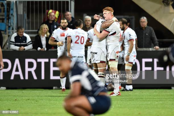 Lyon's player Felix Lambey celebrates after winning the French Top 14 rugby union match between SU Agen and Lyon on October 07 2017 at the Armandie...