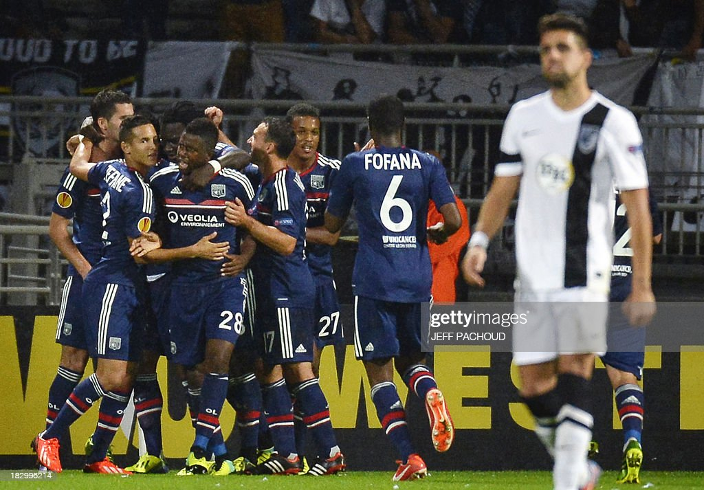 Lyon's players celebrate after Lyon's French midfielder Maxime Gonalons scored a goal during the UEFA Europa League group I football match Olympique Lyonnais (OL) vs Vitoria Guimaraes on October 3, 2013, at the Gerland Stadium in Lyon, central-eastern France.