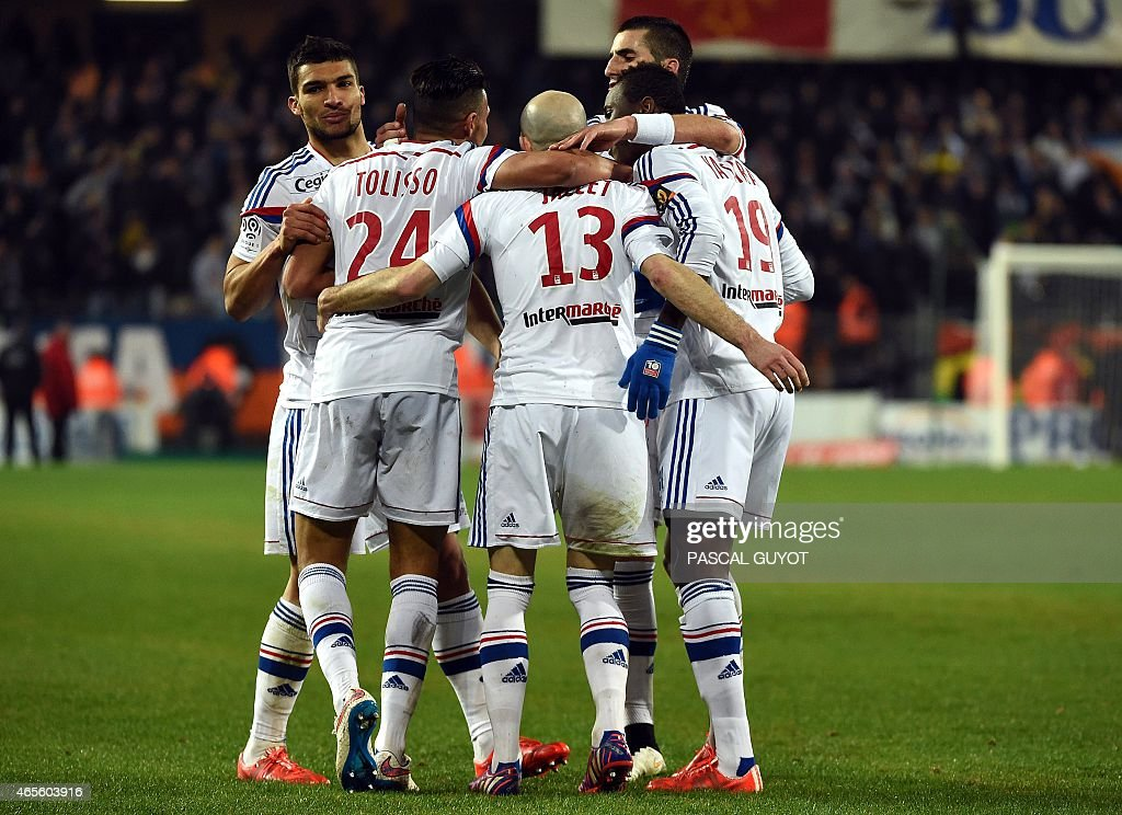 Lyon's players celebrate after scoring a goal during the French L1 football match between Montpellier and Lyon on March 8, 2015 at the La Mosson Stadium in Montpellier, southern France.
