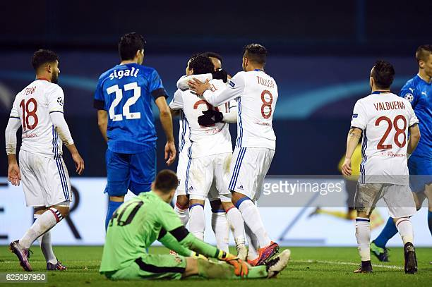 Lyon's players celebrate after scoring a goal during the UEFA Champions League Group H football match between GNK Dinamo Zagreb and Olympique...