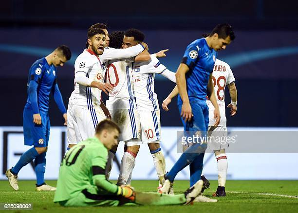 TOPSHOT Lyon's players celebrate after scoring a goal during the UEFA Champions League Group H football match between GNK Dinamo Zagreb and Olympique...