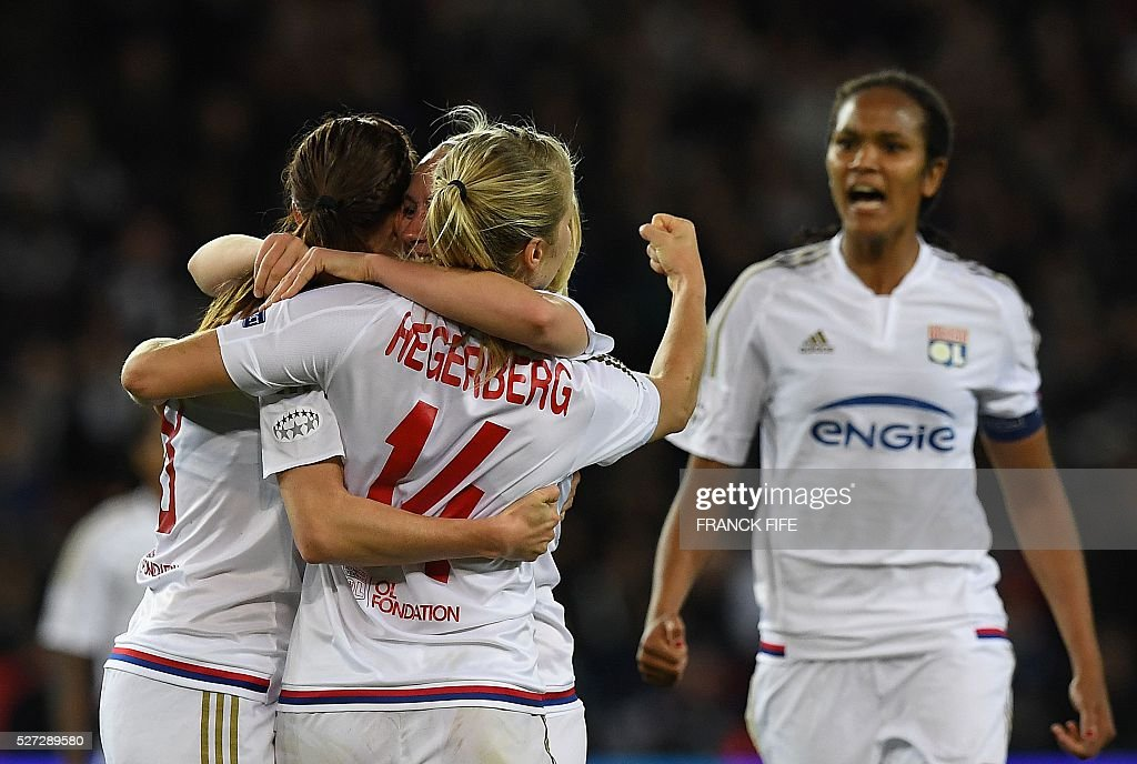 Lyon's players celebrate after scoring a goal during the UEFA Women's Champions League semi-final second leg football match between Paris Saint-Germain (PSG) and Lyon at the Parc des Princes stadium in Paris on May 2, 2016. / AFP / FRANCK