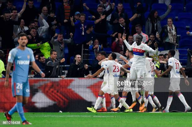 Lyon's players celebrate after thier teammate French forward Nabil Fekir scored a goal during the French L1 football match between Lyon and Monaco on...