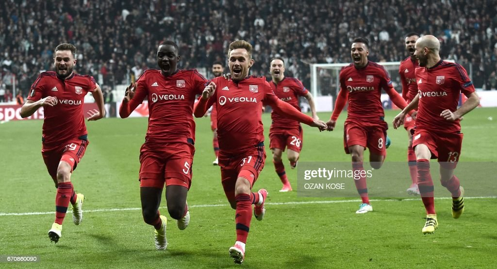 Lyon's players celebrate their victory at the end of the UEFA Europa League second leg quarter final football match between Besiktas and Lyon (OL) on April 20, 2017, near the Vodafone arena stadium in Istanbul. /