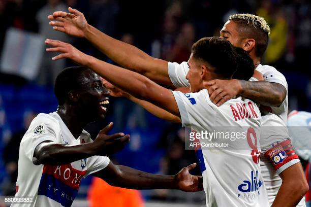 Lyon's players celebrates after scoring a goal celebrate after scoring a goal during the French L1 football match between Lyon and Monaco on October...