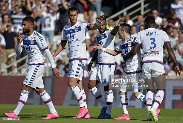 Lyon's players celebrates after scoring a goal during the French L1 football match Lyon vs Rennes on August 22 at the Gerland stadium in Lyon eastern...