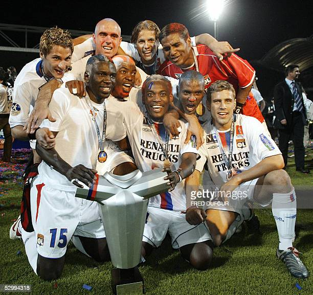 Lyon's players jubilates with their trophy at the end of their French first league football match Lyon vs Nice 28 May 2005 at the Gerland' stadium in...