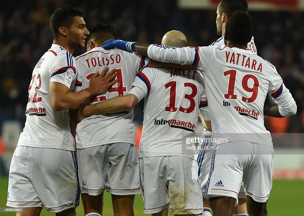 Lyon's players react after scoring a goal during the French L1 football match between Montpellier and Lyon, on March 8, 2015 at the La Mosson Stadium in Montpellier, southern France.