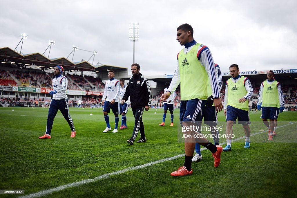 Lyon's players warm up before the French L1 football match between Guingamp and Lyon at the Roudourou stadium in Guingamp, western France, on April 4, 2015.