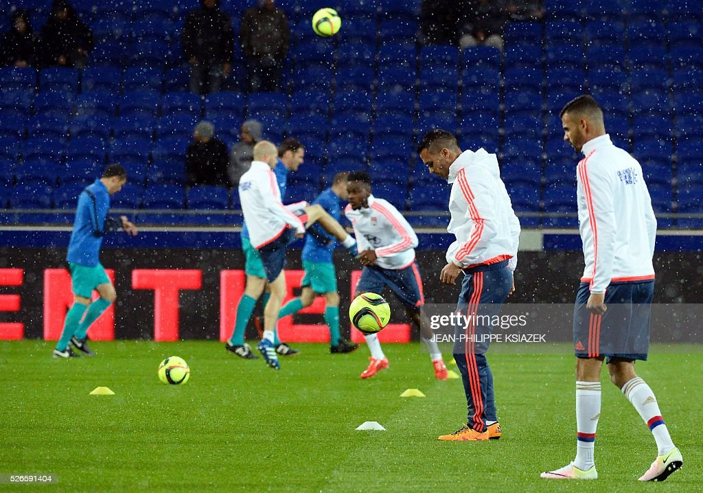 Lyon's players warm up prior to the French L1 football match Lyon (OL) vs Ajaccio (GFCA) at the New Stadium in Decines-Charpieu, central eastern France, on April 30, 2016.