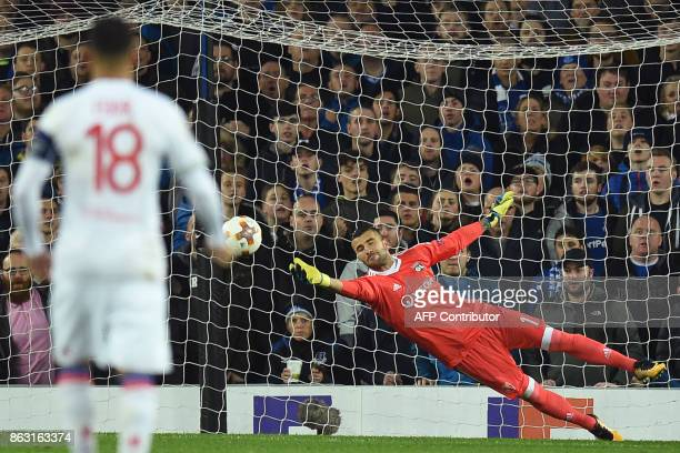 Lyon's Portuguese goalkeeper Anthony Lopes makes a save from Everton's English defender Mason Holgate's crossshot during the UEFA Europa League Group...