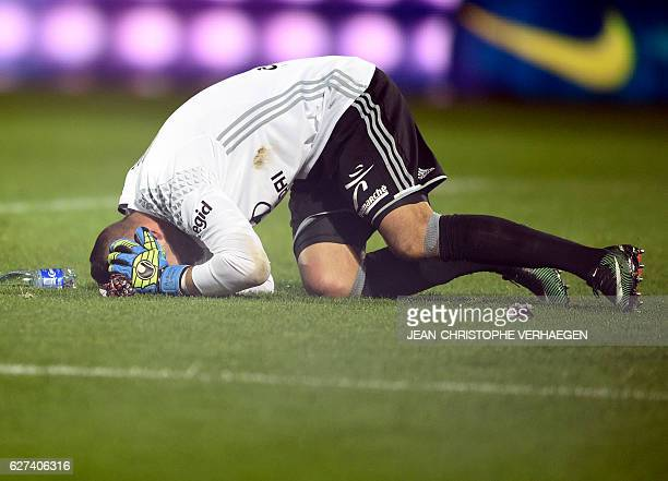 Lyon's Portuguese goalkeeper Anthony Lopes reacts after a firecracker exploded beside him during the French L1 football match between Metz and Lyon...