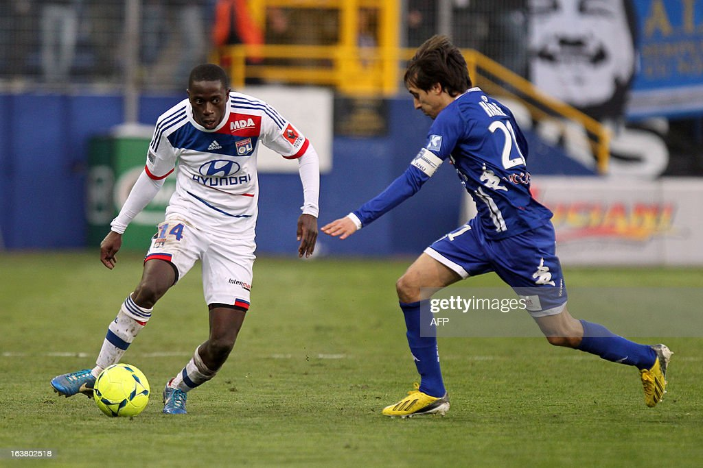 Lyon's Senegalese defender Mouhamadou Dabo vies for the ball with Bastia's Algerian defender Fethi Harek during the French L1 football match Bastia...