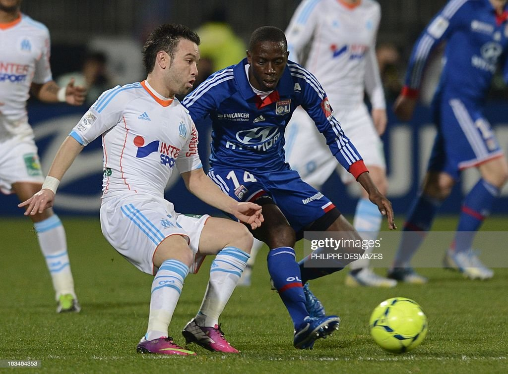 Lyon's Senegalese defender Mouhamadou Dabo (R) vies with Marseille's French forward Mathieu Valbuena (L) during the French L1 football match Olympique Lyonnais (OL) vs Olympique de Marseille (om) on March 10, 2013 at the Gerland stadium in Lyon, southeasthern France. AFP PHOTO/PHILIPPE DESMAZES