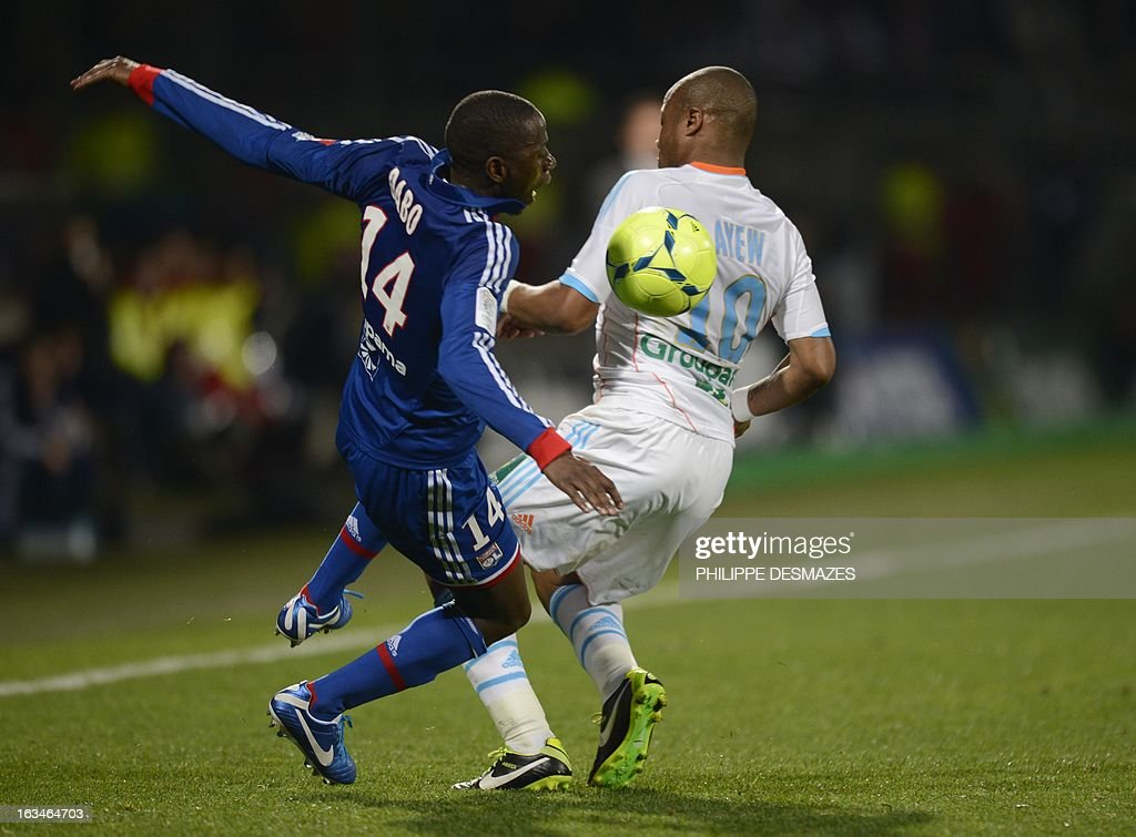 Lyon's Senegalese defender Mouhamadou Dabo (L) vies with Marseille's French forward Andre Ayew (R) during the French L1 football match Olympique Lyonnais (OL) vs Olympique de Marseille (om) on March 10, 2013 at the Gerland stadium in Lyon, southeasthern France.