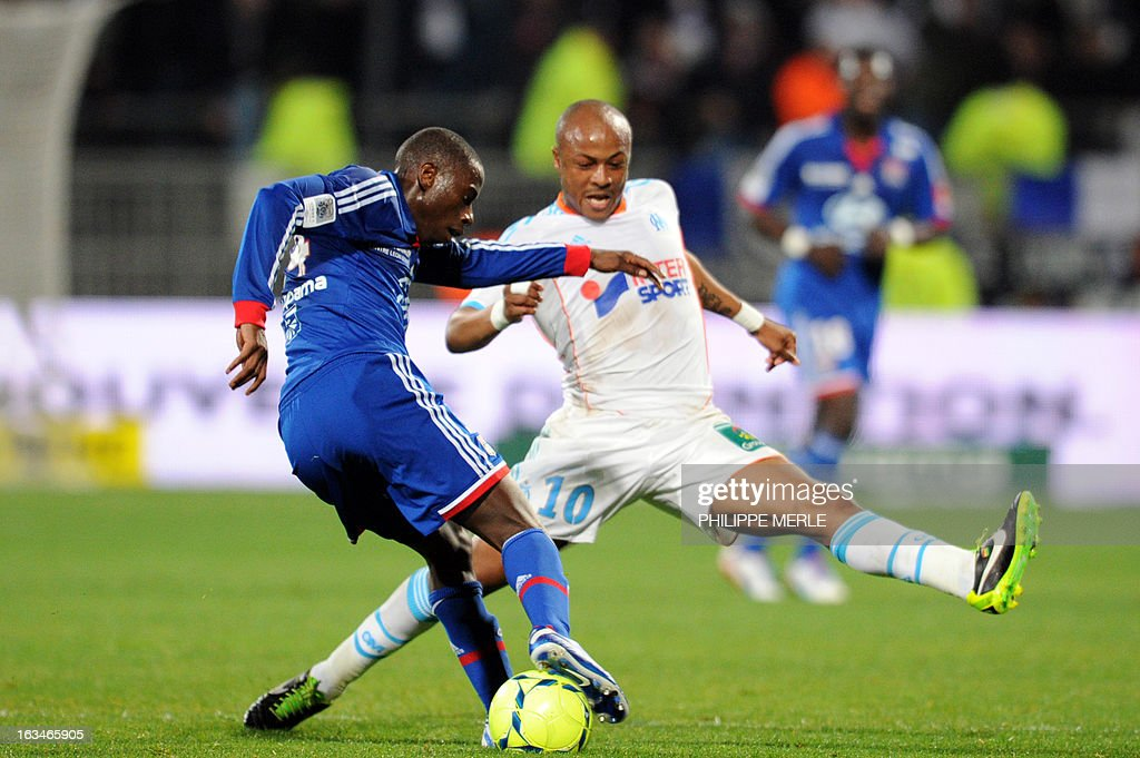 Lyon's Senegalese defender Mouhamadou Dabo (L) vies with Marseille's Ghanaian forward Andre Ayew during the French L1 football match Olympique Lyonnais (OL) vs Olympique de Marseille (OM) on March 10 , 2013 at the Gerland stadium in Lyon. MERLE