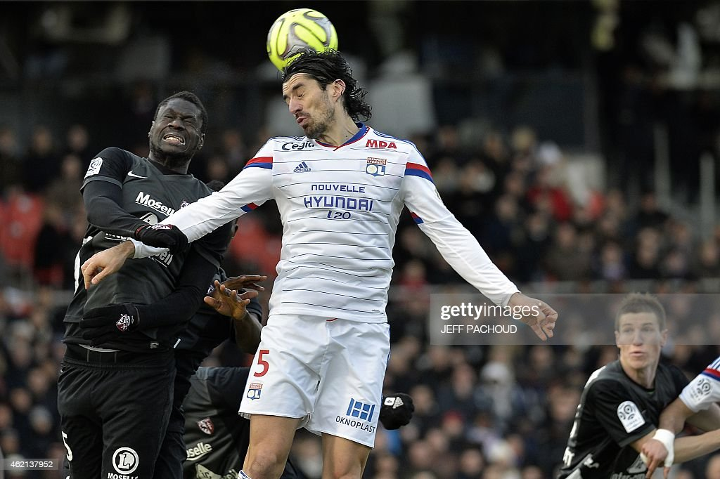 Lyon's Serbiain defender <a gi-track='captionPersonalityLinkClicked' href=/galleries/search?phrase=Milan+Bisevac&family=editorial&specificpeople=600075 ng-click='$event.stopPropagation()'>Milan Bisevac</a> (R) vies with Metz's Senegalese midfielder Guirane N Daw (L) during the French L1 football match Olympique Lyonnais (OL) vs FC Metz (FCM) on January 25, 2015, at the Gerland Stadium in Lyon, central-eastern France.