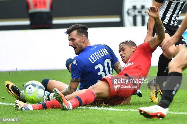 Lyon's Spanish forward Mariano Diaz fails to score a goal past Angers' French goalkeeper Alexandre Letellier during the French L1 football match...