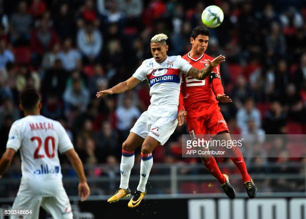 Lyon's Spanish forward Mariano Diaz vies for the ball with Rennes' French midfielder Benjamin Andre during the French L1 football match between Stade...