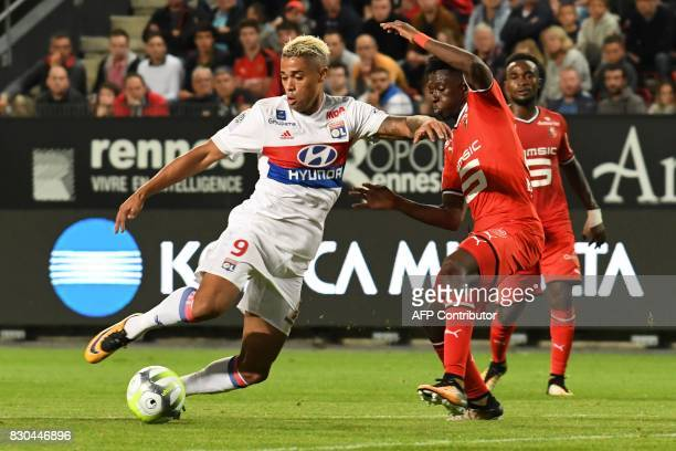 Lyon's Spanish forward Mariano Diaz vies for the ball with Rennes' French defender Romain Danze during the French L1 football match between Stade...