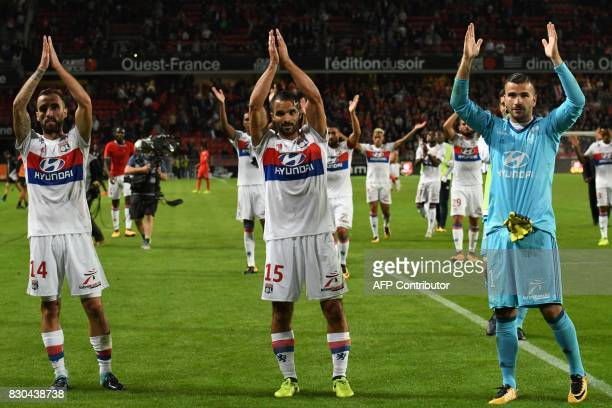 Lyon's Spanish midfielder Sergi Darder French defender Jeremy Morel and FrenchPortuguese goalkeeper Anthony Lopes celebrate after the French L1...
