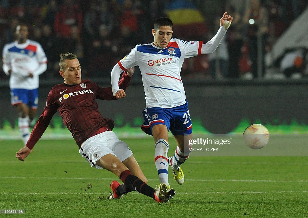 Lyon's striker Yassine Benzia (R) and Sparta Praha's defender Ondrej Svejdik vie for the ball during the UEFA Europa League Group I football match Sparta Praha vs Lyon in Prague, Czech Republic on November 22, 2012. The match ended 1-1.