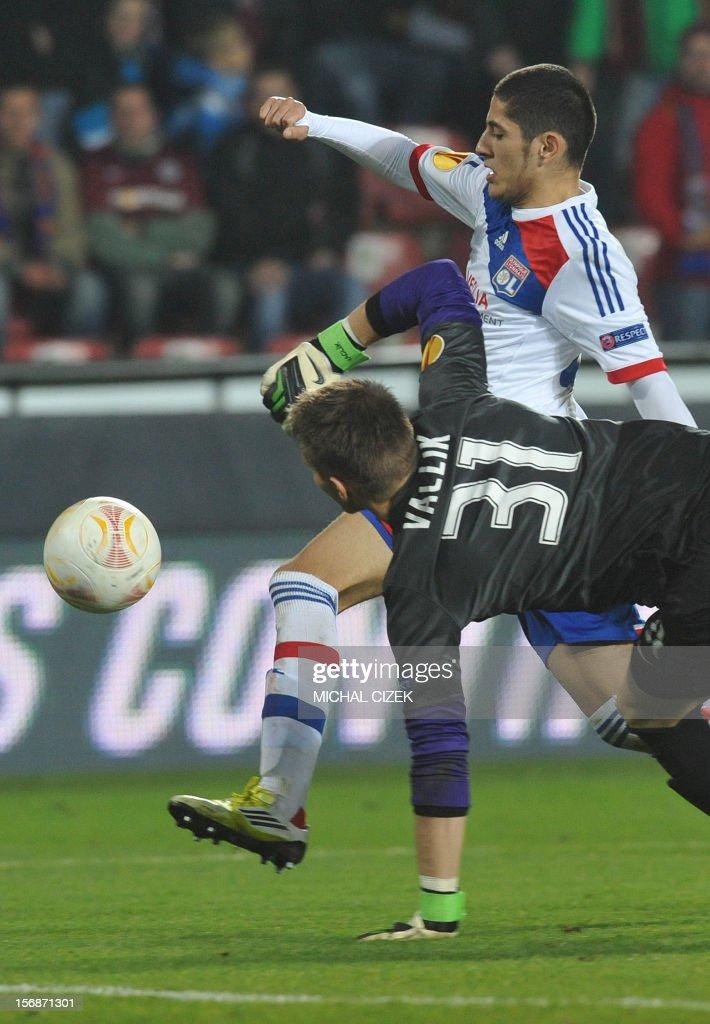 Lyon's striker Yassine Benzia scores past Sparta Praha's goalkeeper Tomas Vaclik (in foreground) during the UEFA Europa League Group I football match Sparta Praha vs Lyon in Prague, Czech Republic on November 22, 2012.