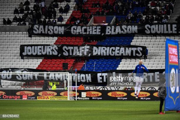 Lyon's supporters placed a banner reading 'wasted season dirty blason' during the French Ligue 1 football match between Olympique Lyonnais and Nancy...