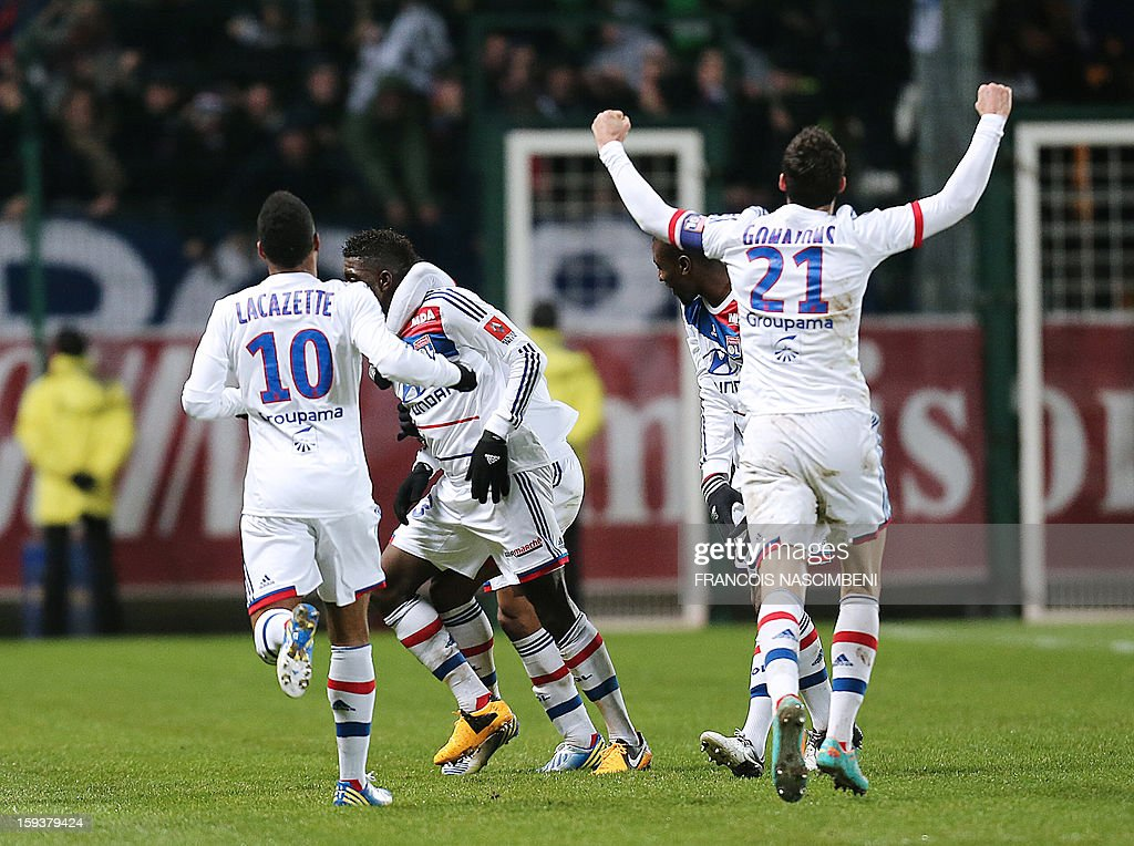 Lyon's team mates celebrate after Samuel Um Titi scored a goal during a French L1 football match between Troyes and Lyon on January 12, 2013 at the Aube Stadium in Troyes.