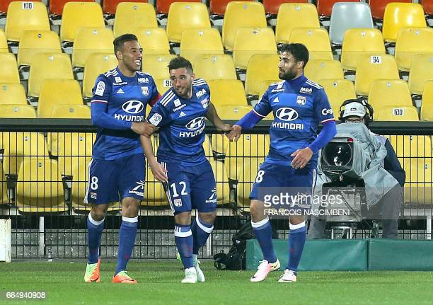 Lyon's teammates celebrate after Lyon's French midfielder Jordan Ferri scored a goal during the French Ligue 1 football match between Metz and Lyon...