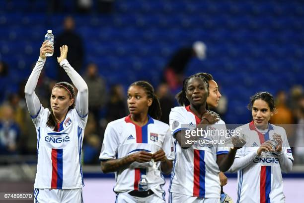 Lyon's US forward Alex Morgan celebrates with teammates at the end of the UEFA Women's Champions League semifinal football match between Lyon and...