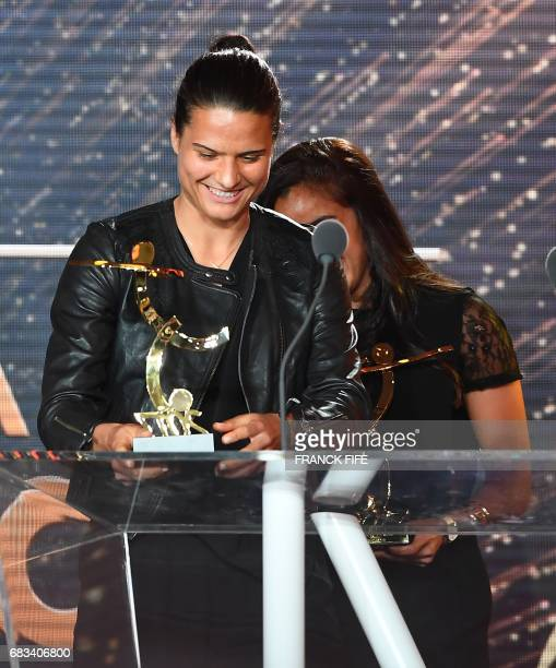 Lyon's women football player Dzsenifer Marozsan receives the award 'best woman player' during the 26th edition of the UNFP trophies ceremony at the...
