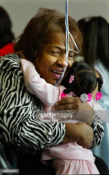 Lyord Knox hugs her newly adopted daughter Lakeisha Knox age 3 who she has had since she was only 4 days old 'She doesn't know any other mother' said...