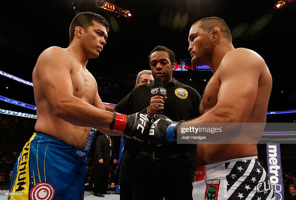 Lyoto Machida (left) and Dan Henderson (right) touch gloves in their light heavyweight bout during UFC 157 at Honda Center on February 23, 2013 in Anaheim, California.
