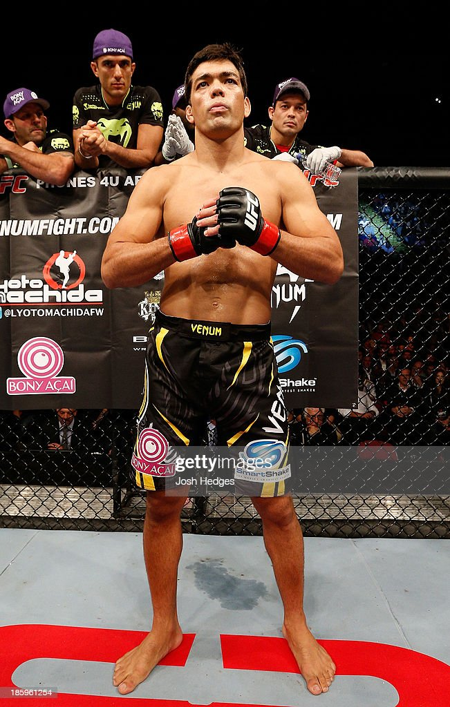<a gi-track='captionPersonalityLinkClicked' href=/galleries/search?phrase=Lyoto+Machida&family=editorial&specificpeople=4137146 ng-click='$event.stopPropagation()'>Lyoto Machida</a> is introduced in the Octagon before his middleweight bout against Mark Munoz during the UFC Fight Night event at Phones 4 U Arena on October 26, 2013 in Manchester, England.