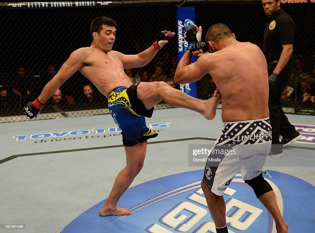 Lyoto Machida kicks Dan Henderson in their light heavyweight bout during UFC 157 at Honda Center on February 23, 2013 in Anaheim, California.